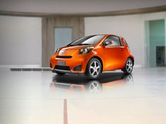 New Scion iQ - CUTE!! - starts at $15,995. has a backseat, 36/37 MPG, 11 airbags - this may be a contender...
