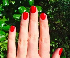 bright red nails.