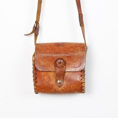 Tooled Leather Distressed Cross Body Bag.