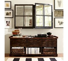I love how they disguised the flat screen TV with mullioned, mirrored doors. Portland Media Console | Pottery Barn