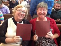 Joelle Colville-Hanson, an ELCA pastor, (left) and Anita Tubben-Nueztmen hold service folders from the service of Holy Communion and the Installation of the Presiding Bishop of the Evangelical Lutheran Church in America. To learn more about the ELCA or to find an ELCA congregation go to ELCA.org.