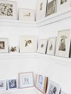 Simple ledges display family photos in the living room.