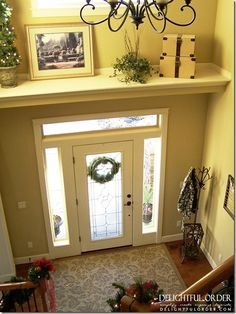 Add a shelf above the door to break up the large wall space in a two story foyer.