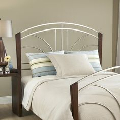 Sorrento Headboard in Nickel and Light Cherry Size: King    Features: -Headboard. -Sorrento collection. -Nickel and cherry finish. -Available in Twin, Queen or King sizes.    $397.99