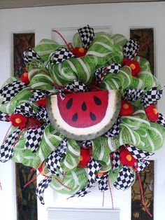Summer Deco Mesh wreath made for my front door! :) Green and white mesh, black and white ribbon purchased at Hobby Lobby.   Watermelon  sign painted by me.   Red flowers are pool noodle slices painted red with a yellow pomp pomp in the center.