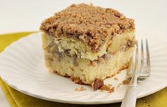 Apple Streusel Coffee Cake A moist soft coffee cake with a layer of streusel and apples in the center of the the cake and generous about of streusel for the topping. Welcome in Fall with this delicious coffee cake!
