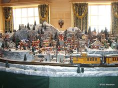 This beautiful snowy village and miniature train is part of The Yacht Club resort's Christmas decorations christma villag, garden train, christmas decorations, miniatur train, christmas trees