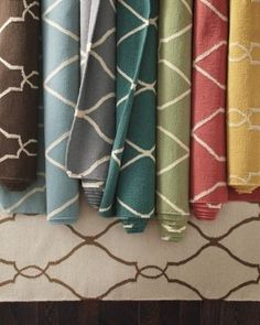 Tons of affordable rugs.  www.theschaeferhouse.com  (Looks like your dining room walls)