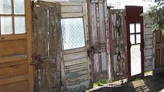 old doors make an awesome fence! What a cool idea! Love it!