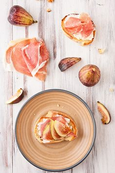 // Crostini with Figs, Prosciutto and Goat Cheese.