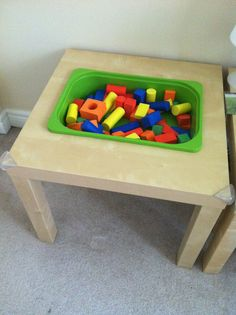 Ikea hack  Lack side table + plastic storage bin = DIY Sensory table! Fill with blocks/sand/rice/pasta etc.