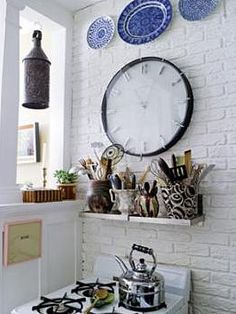 Love this clock against the brick wall
