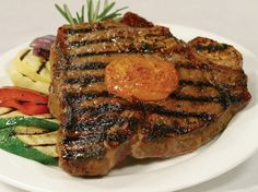 Porterhouse steak with Maytag blue cheese and sun dried tomato butter