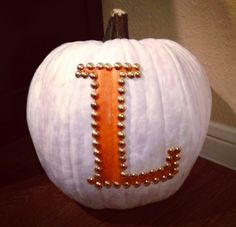Painted pumpkin with initial outlined in thumbtacks - 60 No Carve #Pumpkin #Decorating #Ideas