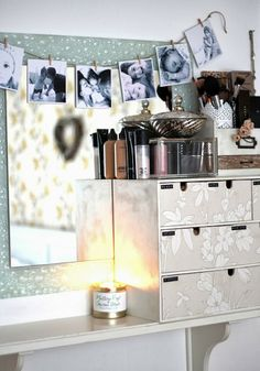 Makeup storage in Ikea wooden boxes covered in wallpaper