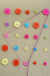 Buttons and yarn DIY geoboard