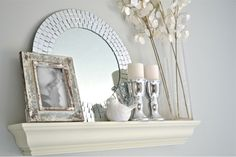 Pretty! Love the idea of using a mirror on the floating shelf.