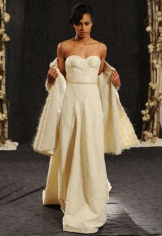 Anne Bowen Fall/Winter 2014 collection features gowns wrapped in a frosted, ivory mohair.   Kurt Wilberding   The Knot blog