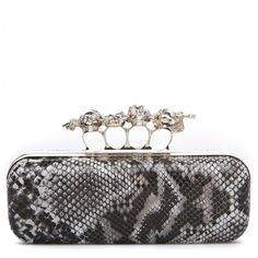 "Wooton ""Rocker-glam clutch"" - smooth faux-snakeskin surface with built in handle/rings with skulls"