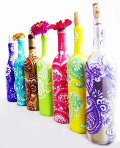 Up-Cycled Wine Bottles. Perfect for home decor and gifts.