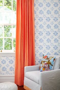 girl's rooms - coral silk drapes off-white slipcover chair orange band turquoise blue pillow Coral sik curtains, blue wallpaper, off-white slipcover