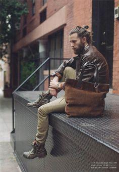 Man bun, man bag, beard and leather. Love it.
