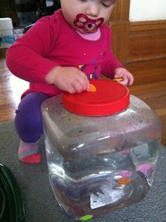 Coins in a Water Jar. Great way to enhance fine motor skills on little ones.