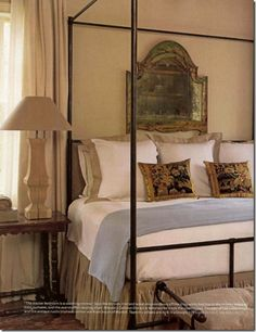antique mirror over bed