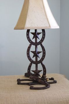 Horseshoe lamp... Bet Marcus could make this for me