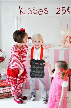 Valentine's party kissing booth with Lots of REALLY CUTE IDEAS via Kara's Party Ideas karaspartyideas.com