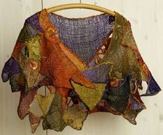 Zann Carter won Most Innovative with her capelet combining pieces woven on several different-sized triangular looms with crochet joins and embellishments.