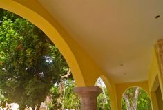 Arches and stone columns of the private terrace. Hacienda del Río Custom Homes model home. Playa del Carmen real estate area.