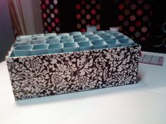 Another tp roll storage thingamajig. I did this one with contact paper outside and painted the tubes Tiffany blue.~Ronda Vallejo at home