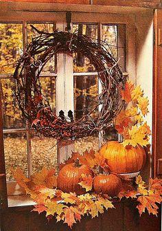 GORGEOUS old window with grapevine wreath & fallen autumn leaves & pumpkins under it.