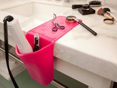 A silicone heat resistant pocket that keeps hot irons & hair dryers safe & organized.