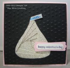 handmade Valentine card: Iris Folded Kisses ... silver glitter paper used to make iris fold Hershy's Kiss ... great look on black ... Stampin Up!