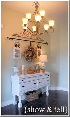 entry way...hang wreath from curtain rod and hang pics and other decor around it. SO CUTE