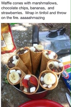 Waffle Cone S'mores! Strawberries, bananas, chocolate chips, and marshmallows in a waffle cone. Wrap in foil and place in the campfire coals or on the grill.