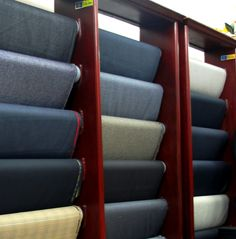 Part of our beautiful wall of men's suit fabrics. All of our fabric is created using centuries old techniques from England and Italy. Check our website for our currently available fabrics.
