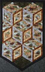 """Diamonds of Yellowstone - Pick out your most interesting fabric to showcase in this wallhanging pattern. Fussy cut those prints into 4, 6 or 8 inch diamonds and join together for this interesting design. Border strips frame the blocks to add depth. Try some vivid wildlife fabric and make a beautiful quilt for the men in your life, or maybe flowers or dancers for a little girl, the possibilities are endless.   Size: 38"""" x 42""""  http://www.kayewood.com/item/Diamonds_of_Yellowstone_Pattern/251 $8.00"""