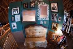 """One of my favorite aspects of our wedding...the photo booth!  Made to look like a vintage living room complete with photos of our relatives hanging on the walls and who frames cut out for people to stand behind to be a """"live photo""""."""