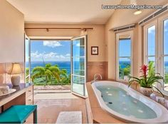 Love this ocean view bathroom design and decor in this home in Hawaii!
