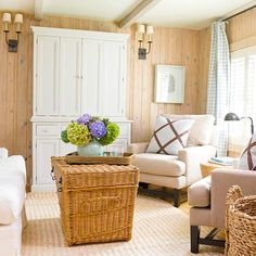 We love the wood-paneled walls in this space! More living room design ideas: http://www.bhg.com/rooms/living-room/makeovers/living-room-decorating-ideas/?socsrc=bhgpin062613woodwalls=19