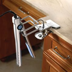 Hot iron and hair dryer holder by Hammacher Schlemmer...I need one of these...maybe then I won't break as many flat irons on the floor...
