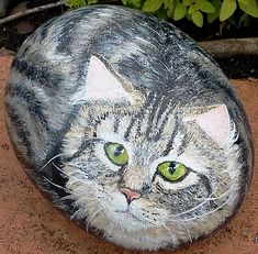 How to Paint Stones: Cat Portrait  Really good step-by-step instructions too!