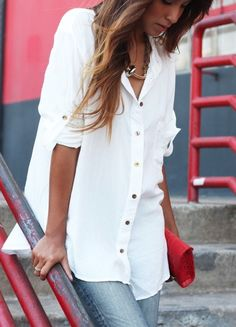 Gold buttons. Oversized white shirt.