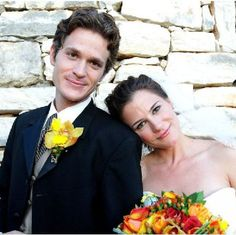 beautiful bride and groom - love the yellow in his boutonniere