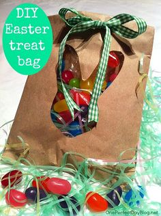 Cute little diy candy bags for Easter. Could be adapted to any party theme by changing the shape of the window.