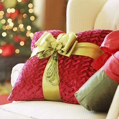Buy pillows in Christmas colors and tie them with a bow...........love this!