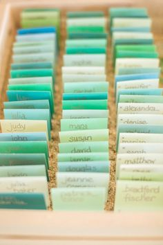 beach wedding: sea greens and blues {paint chips?} seating cards set in sand chip, escort cards, color, wedding planning, place cards, name cards, seaside wedding, seating cards, paint